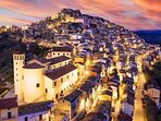 Our medieval hillside by night.  You will love the food, friendliness, and your stay here. Venire!