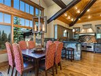 Dining Room with Seating for 8 located on the Main Level and a Private Deck with a BBQ Grill