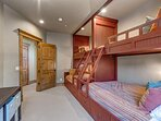 Upper Level Bedroom 5 -  Bunk Room with Two Twin Beds over Two Queen Beds and a Shared Bath