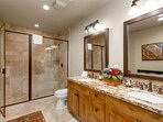 Upper Level Shared Bathroom with Dual Sinks and a Euro Stone Shower