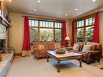 Lower Level Family Room with Gas Fireplace, Wet Bar, Smart TV, and a Private Deck Overlooking the Mountains