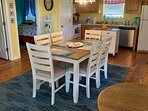 Extra seating at small table with bench seating