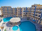 A birds view of Tiba Resort with the two large swimming pools and the two smaller kids pools.