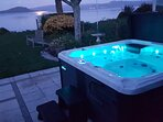 Spa, views out to lake, choose your might mood colour, waterfall and therapeutic jets